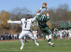 Bonny Eagle's Kordell Menard makes a diving catch as Portland's Vincent Pasquali tries to break up the play during Saturday's Class A state championship game at Fitzpatrick Stadium in Portland. (Shawn Patrick Ouellette/Staff Photographer)