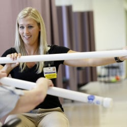 Erica Lyford, an occupational therapist at Mayo Regional Hospital in Dover-Foxcroft, works with a patient. Mayo and other rural care facilities are increasingly relying on rehab and other outpatient services as revenue from inpatient health care plummets.