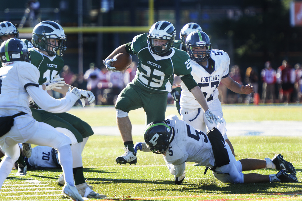 Bonny Eagle running back Alex Sprague eludes defenders during the Scots' 34-14 win over Portland in the Class A state championship game Saturday at Fitzpatrick Stadium.