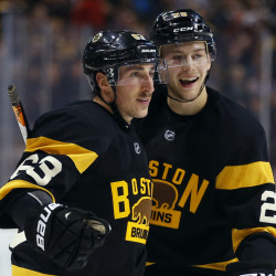 Boston Bruins' Brad Marchand (63) celebrates his goal with Brandon Carlo during the second period of an NHL hockey game against the Winnipeg Jets in Boston on Saturday, Nov. 19, 2016. (Associated Press/Winslow Townson)