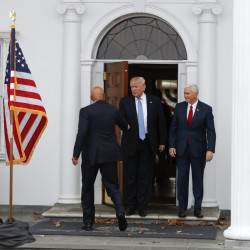 President-elect Donald Trump, center, and Vice President-elect Mike Pence greet Peter N. Kirsanow, a member of the U.S. Commission on Civil Rights, at the Trump National Golf Club Bedminster in Bedminster, N.J., Saturday.