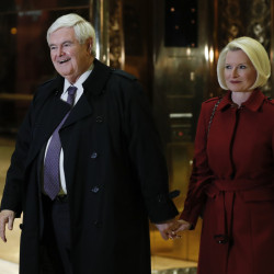 Former House Speaker Newt Gingrich and his wife Callista Gingrich walk through Trump Tower on Monday after meeting with President-elect Donald Trump.