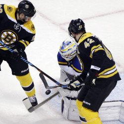 Blues goalie Jake Allen keeps the puck in front as Bruins left wing Brad Marchand (63) and right wing David Backes (42) try to score in the third period Tuesday night in Boston. St. Louis won 4-2.
