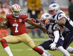 Trey Flowers, right, and Patrick Chung of the New England Patriots were part of a defense that sacked Colin Kaepernick of the San Francisco 49ers five times Sunday, all in the first half.