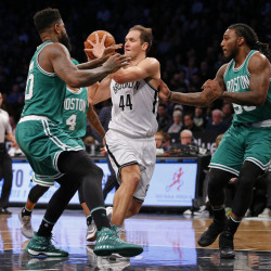 Bojan Bogdanovic of the Nets looks to pass the ball as Boston's Amir Johnson, left, and Jae Crowder defend in the first half Wednesday night in Brooklyn, N.Y.