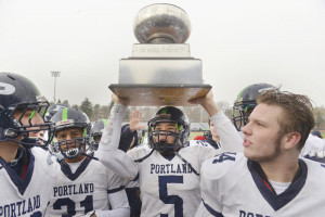Portland quarterback Issiah Bachelder holds the trophy after his team's win over the Rams.