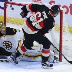 Ottawa's Mark Stone beats Boston goalie Tuuka Rask for second-period goal, tying the game 1-1, in Ottawa on Thursday night. The Senators scored twice in the third period for a 3-1 win. (The Canadian Press/Sean Kilpatrick)