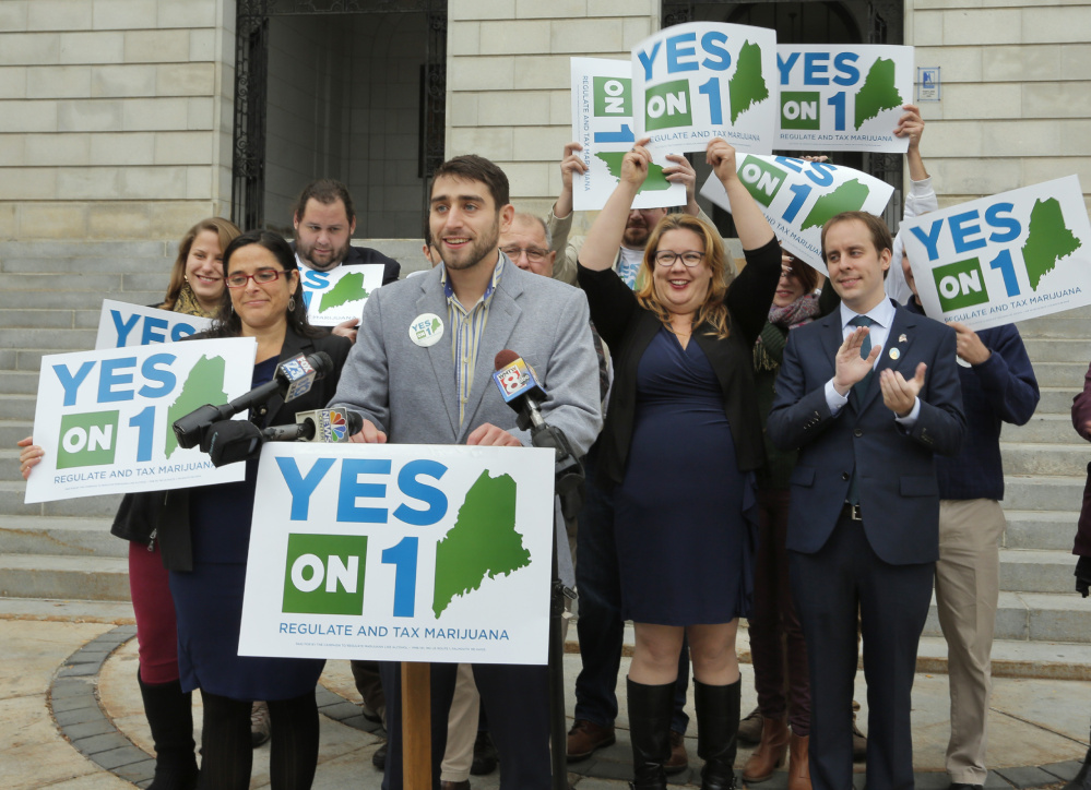 Proponents of the marijuana legalization referendum claim victory Nov. 9 at at City Hall in Portland. Recount results confirmed their victory, by about 4,000 votes.