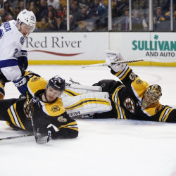 Bruins' goalie Tuukka Rask sprawls on the ice as Colin Miller, 6, defends against Tampa Bay Lightning's Erik Condra during the third period of Boston's 4-1 win Sunday in Boston.