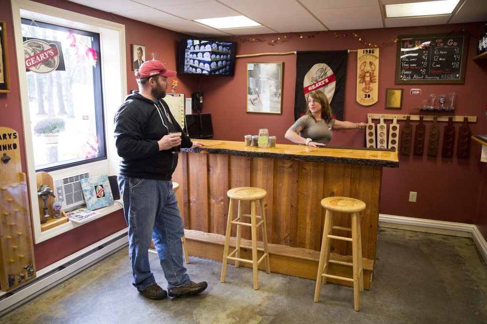 Peter Heggeman, head brewer at Geary's, and Danielle Coons, the tasting room ambassador, chat in Geary's tasting room. The brewery, which has been around since 1983, is Maine's oldest craft brewery.