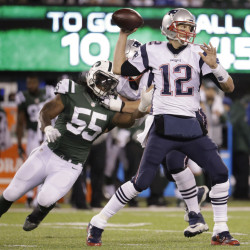 Patriots quarterback Tom Brady earned his 200th win and surpassed 60,000 yards passing Sunday, but looked lost trying to block for LeGarrette Blount.