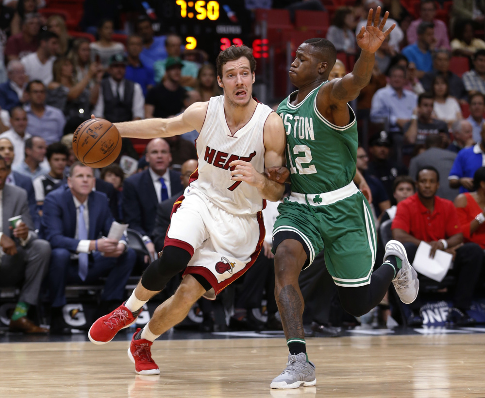 Miami heat basket - Miami Heat Guard Goran Dragic Drives To The Basket Against Celtics Guard Terry Rozier In The
