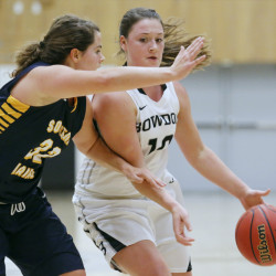 Bowdoin's Lauren Petit tries to drive past Southern Maine's Mychaela Harton during the Polar Bears' 85-40 win Tuesday in Brunswick.