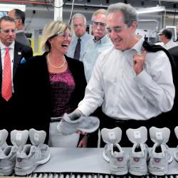 U.S. Trade Representative Michael Froman examines a sneaker at the New Balance plant in Norridgewock during a tour in 2013. Company CEO Rob DeMartini, left, plant Manager Raye Wentworth, then-U.S. Rep. Mike Michaud and U.S. Sen. Angus King accompany him.