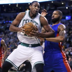 Boston's Al Horford, left, pivots to the basket as he is covered by Detroit's Marcus Morris in the first quarter Wednesday night in Boston.