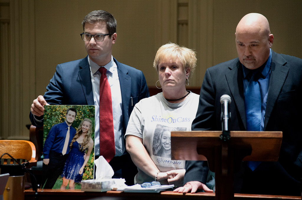 William, right, and Susan Garland speak in Androscoggin County Superior Court in Auburn on Tuesday. Their son, Connor, was with his girlfriend, Cassidy Charette, on the night in 2014 when Charette died in a hayride crash at Harvest Hill Farm. Attorney Alexander Spadinger holds a picture of Connor Garland and Charette. Daryn Slover/ Sun Journal via AP