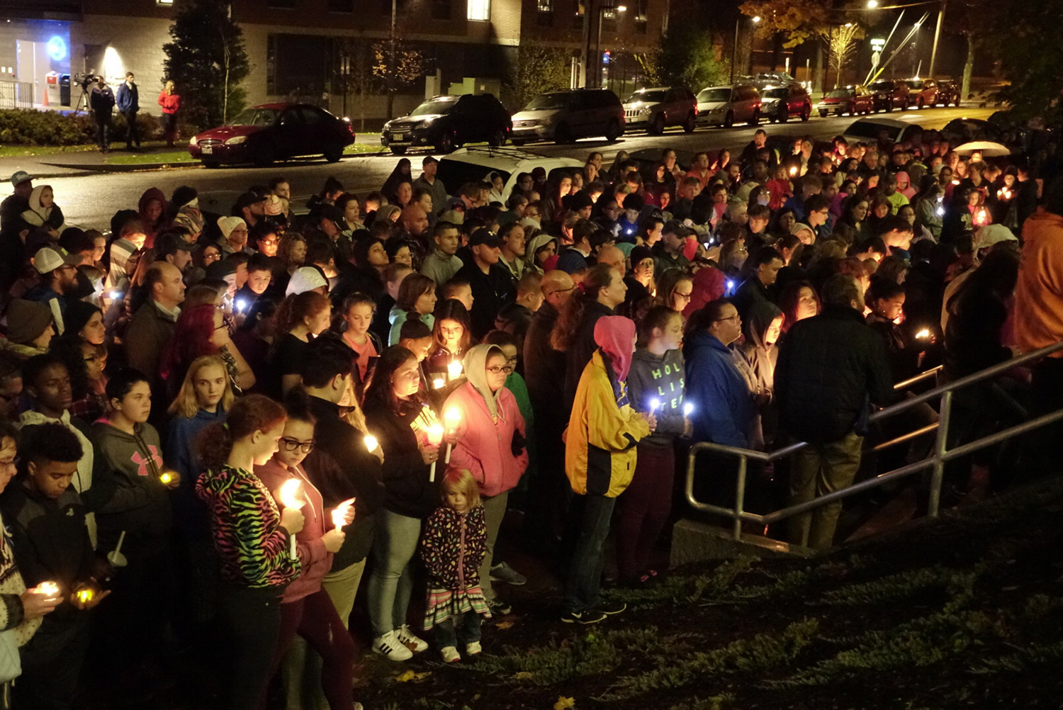 A crowd gathers in Lewiston on Thursday night for a vigil for Jayden Cho-Sargent, an eighth-grader who was killed Thursday morning while crossing Main Street about a block from his home.