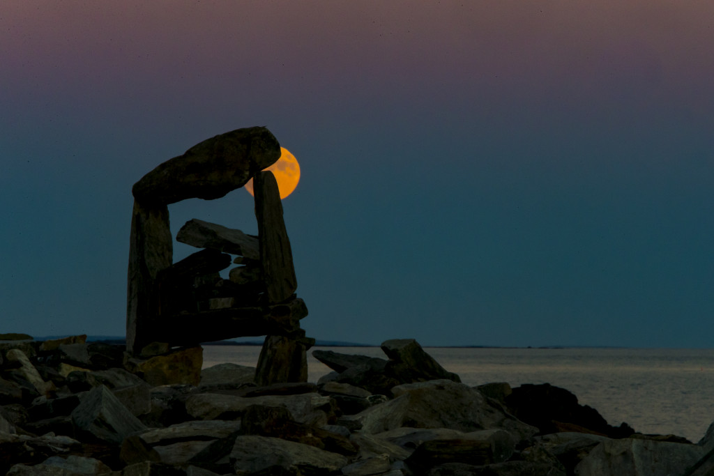 The supermoon is seen Sunday night  from the back shore of Peaks Island in Casco Bay. Ben McCanna/Staff Photographer