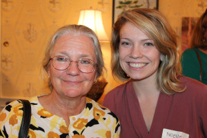 Timmi Sellers, a nurse consultant at the Portland Center for Assisted Living, and Noelle Cooper, a nurse practitioner student at USM, perused the collection of art for sale at the Partners for World Health event at the Cumberland Club in Portland.