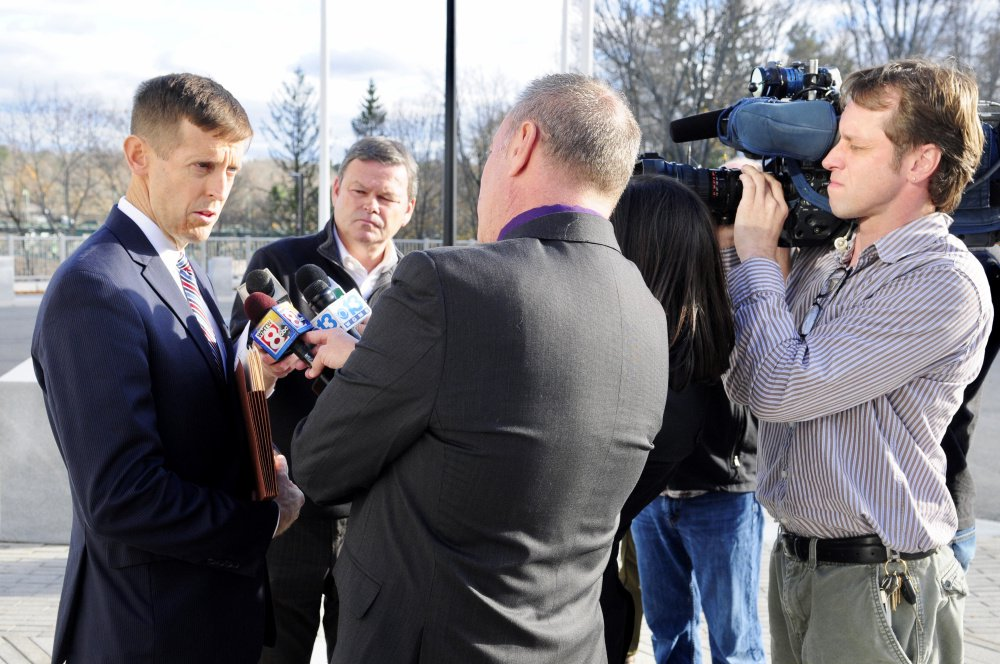 Attorney Walter McKee, who represents Andrew Balcer, 17, of Winthrop, accused of killing his parents, speaks to reporters outside the Capital Judicial Center Thursday following a hearing.