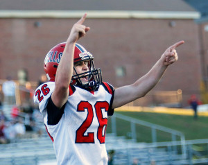 Riley Dempsey of Wells celebrates after teammate Nolan Potter scored a touchdown during the Warriors' 44-0 win over MDI in the Class C state championship game at Fitzpatrick Stadium in Portland on Saturday.