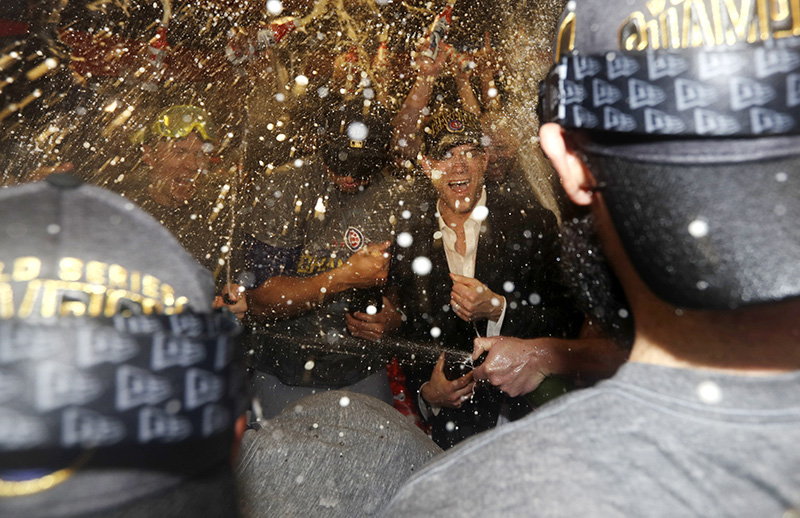 Theo Epstein celebrates with the team after Game 7 of the World Series Thursday.