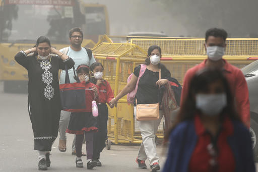 An Indian family arrives at a protest against air pollution in New Delhi on Sunday.  Associated Press/Manish Swarup