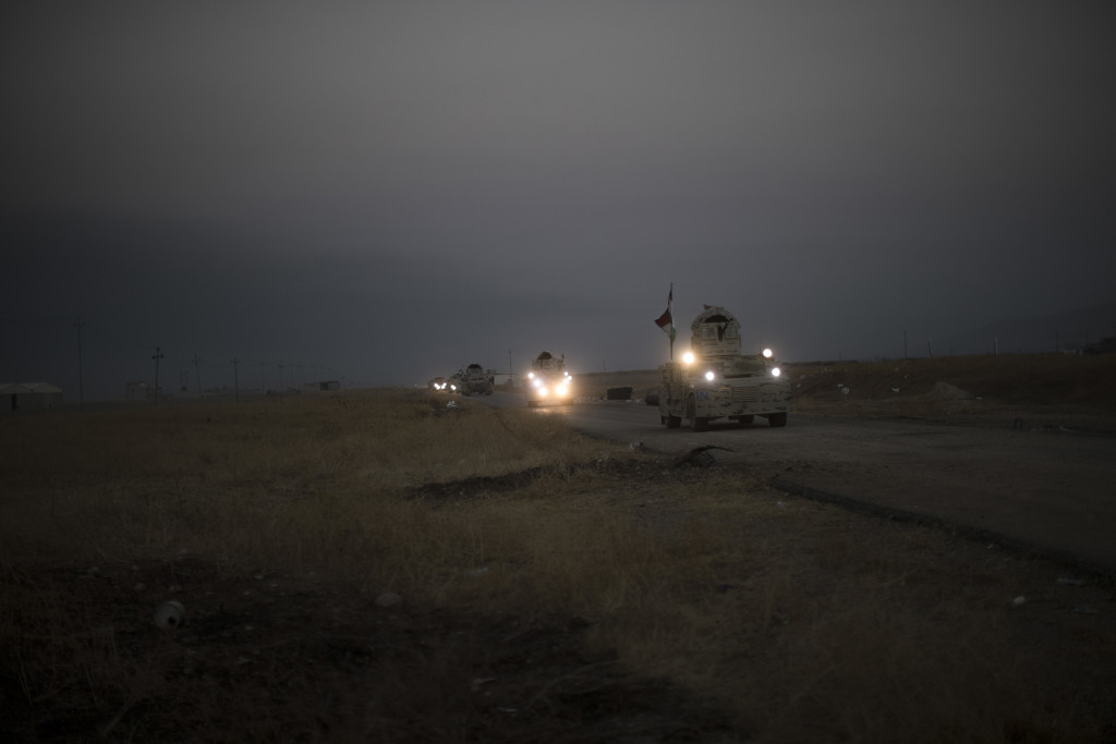 A Kurdish Peshmerga convoy drives toward a front line in Bashiqa, east of Mosul, Iraq, on Monday. (AP Photo/Felipe Dana)