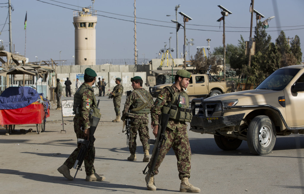 Afghanistan's National Army soldiers guard the main road to the Bagram Airfield's main gate in Afghanistan on Saturday.