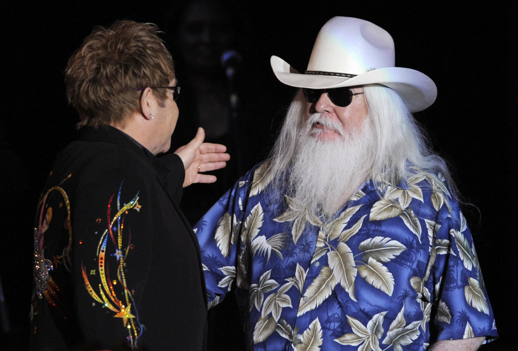 Leon Russell greets Elton John onstage during their joint concert at the Hollywood Palladium in Los Angeles on Nov. 3, 2010.
