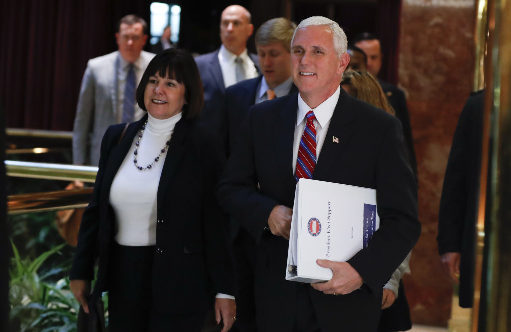 Vice President-elect Mike Pence arrives at Trump Tower on Tuesday with his wife, Karen. Pence and Donald Trump met for close to six hours as they considered key appointments for the new administration.