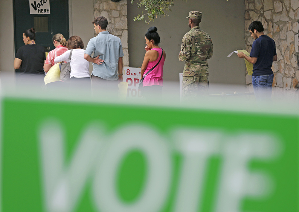 Voters wait in line to cast ballots at an early polling site in San Antonio, Texas, on Nov. 4.  Thanks to early voting, more than 50 million people may have voted before Election Day. <em>Associated Press/Eric Gay</em>