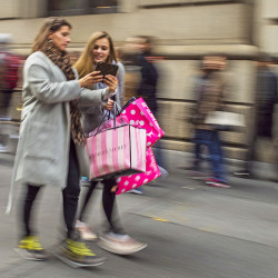Shoppers carry their purchases on Black Friday as they walk along Fifth Avenue in New York. The U.S. economy looks healthy. The government reported Tuesday that the economy grew at a 3.2 percent annual pace from July to September, fastest in two years. Consumer spending advanced at a 2.8 percent annual pace in the third quarter, better than a previous estimate of 2.1 percent. Associated Press/Andres Kudacki