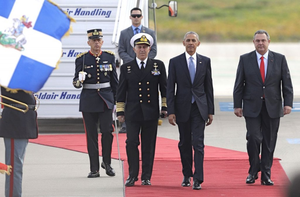 President Barack Obama walks next to Greek National Defense Minister Panos Kammenos, right, after his arrival at the Athens International Airport Eleftherios Venizelos on Tuesday.  <em>Associated Press/Thanassis Stavrakis</em>