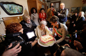Verbania's Mayor Silvia Marchionini, right, presents Emma Morano with a cake on the day of her 117th birthday.