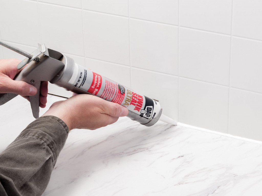 Make bathroom and kitchen areas looks new again by removing the old caulk, and re-caulking.
