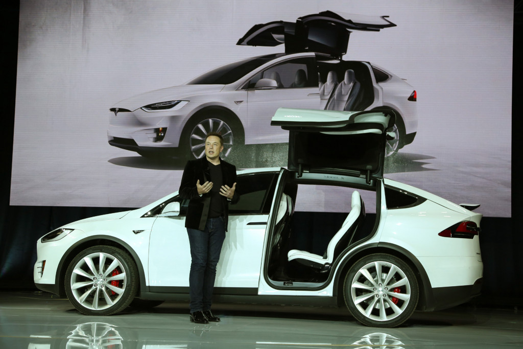 Tesla CEO Elon Musk introduces the falcon wing door on the Model X electric sports-utility vehicle in September 2015.