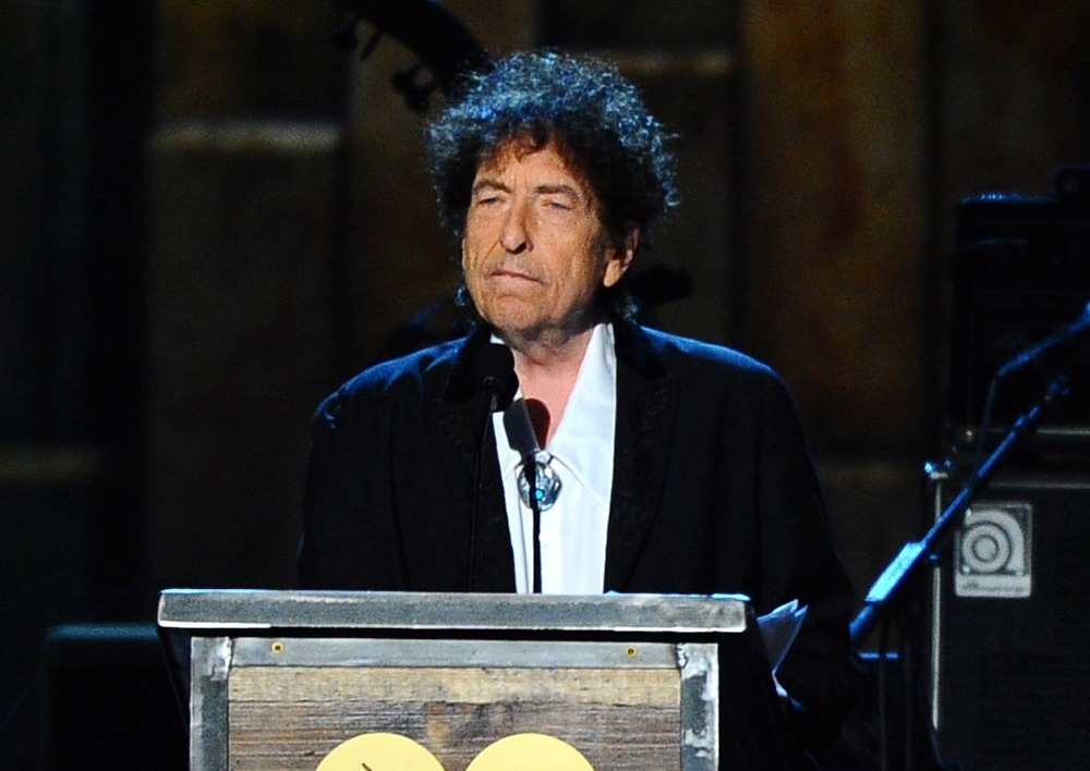 Bob Dylan, shown here accepting the 2015 MusiCares Person of the Year award in Los Angeles, won't travel to Stockholm to receive the Nobel Prize for Literature on Dec. 10, but he is still required to deliver a Nobel lecture within six months of that date. Vince Bucci/Invision/AP