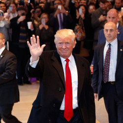 President-elect Donald Trump waves to the crowd as he leaves the New York Times building after a meeting Tuesday in New York.