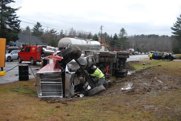 A truck hauling milk was overturned in a crash with a pickup truck on Route 1 in Waldoboro on Wednesday. The driver of the pickup truck died.