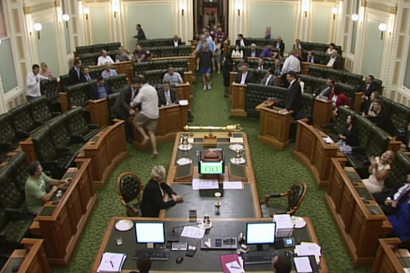 Lawmakers arrivie in the middle of the night at the Australian state Parliament in Brisbane.