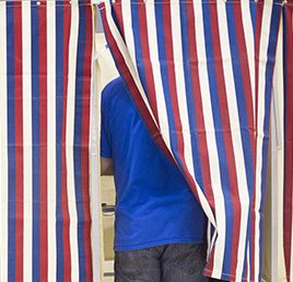 A voter fill out his ballot at Merrill Auditorium in Portland on Election Day 2016.