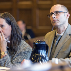 Gregory Nisbet and attorney Sarah Churchill listen Thursday as Justice Thomas Warren sentences the landlord who owned the Portland building where a fire on Nov. 1, 2014, killed six people.