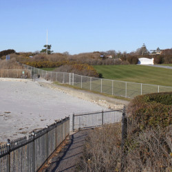 Newport, R.I., officials, environmentalists and residents have complained that the fence, installed earlier this year to replace an old fence, encroaches up to 18 inches onto the Cliff Walk, one of Rhode Island's biggest tourist destinations.