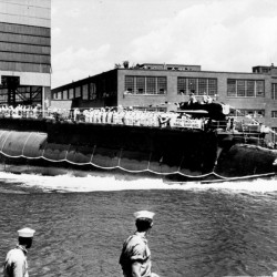 "The USS Thresher is launched bow-first at the the Portsmouth Navy Yard in Kittery on July 9, 1960. A Navy submarine that left a Connecticut base this week is carrying the ashes of a veteran to be buried at sea near the site of the USS Thresher's sinking. For half a century Navy Capt. Paul ""Bud"" Rogers struggled with feelings that it should have been him and not his last-minute replacement on the doomed voyage."