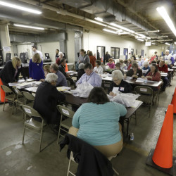 Workers begin a statewide presidential election recount Thursday in Milwaukee, Wisconsin.