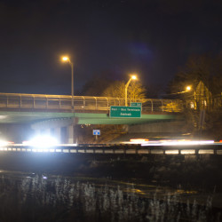 Traffic passes under the Deering Avenue Bridge on Interstate 295 in Portland after nightfall Friday. Soil samples taken before and after four bridges were repainted showed elevated lead levels around the Deering Avenue Bridge.