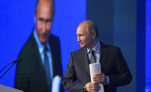 Russian President Vladimir Putin walks to address a forum in Moscow on Wednesday. Putin's agents are believed to be interfering with the governments of Hungary and Montenegro.