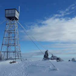 The summit on Pleasant Mountain, which included a hotel from 1873 to 1907, now has a boarded-up Maine Forest Service fire tower and stunning views in all directions.