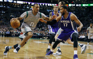 Avery Bradley of the Celtics drives against Sacramento's Garrett Temple during Boston's 97-92 win Friday night at TD Garden.